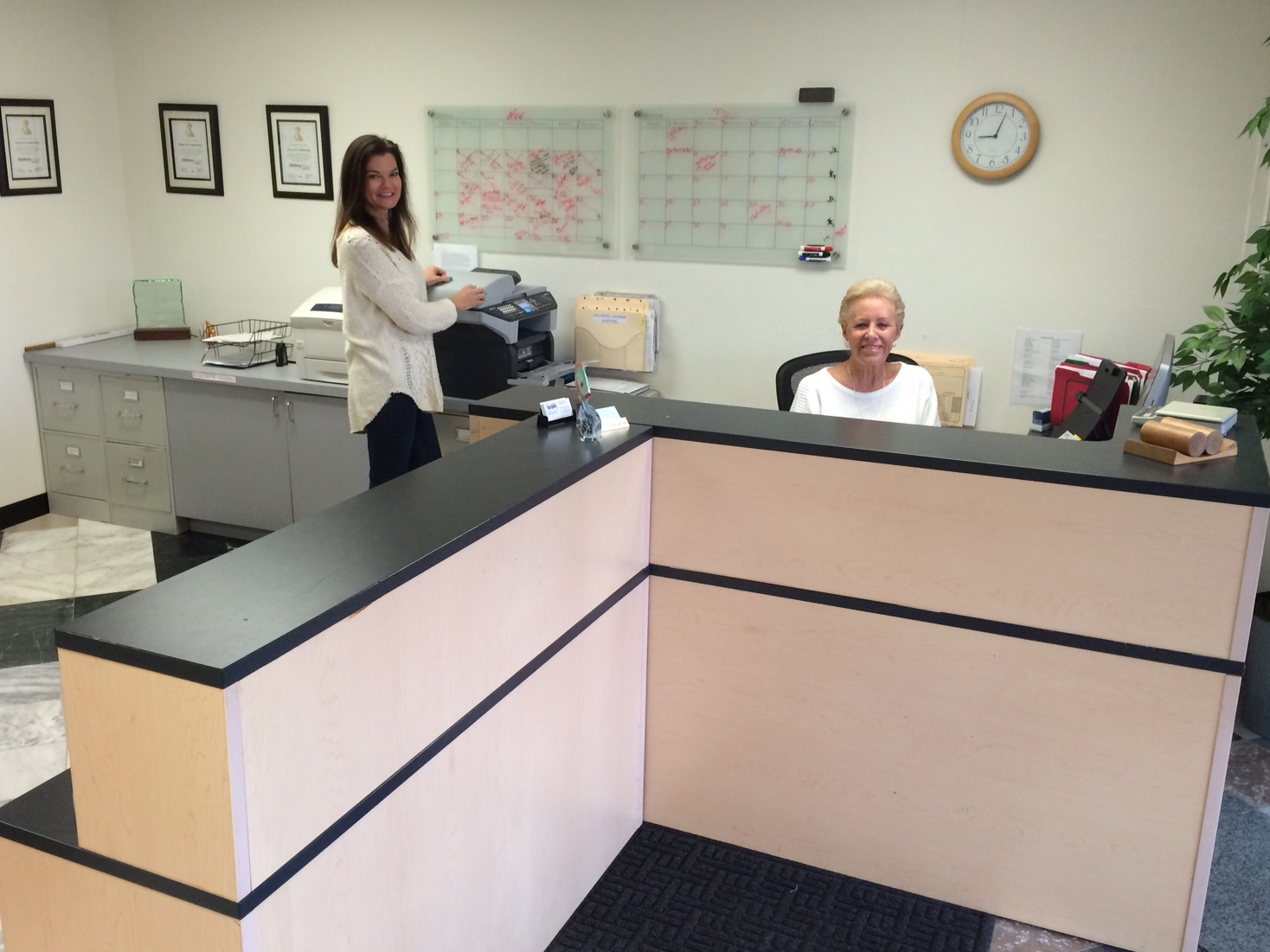 Maureen Reddington and Joan Goodman greet customers with a smile when they come to our office.