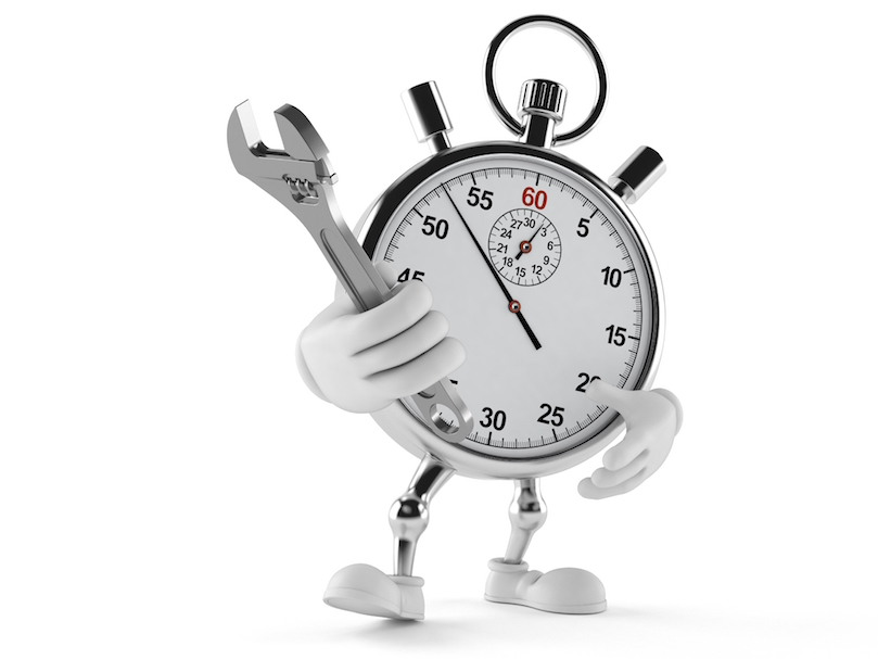 stopwatch with arms and legs holding a wrench
